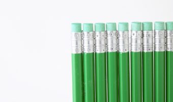 Green pencils in a line